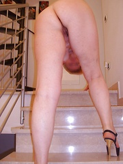 Mature mom with her pussy in heat on the stairs